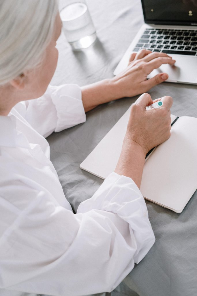 prior authorization lady working on laptop about prior authorization form
